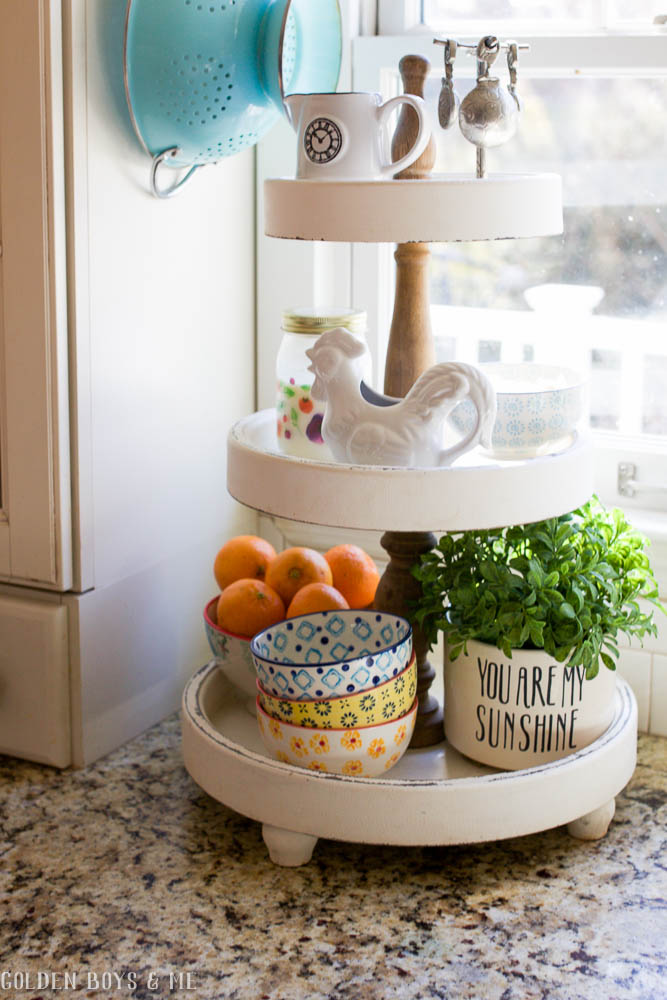3 tiered stand with farmhouse style kitchen items
