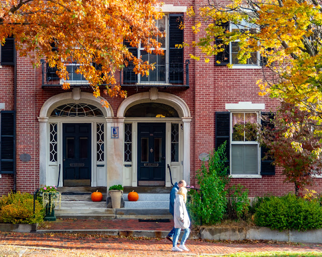 Portland, Maine USA October 2019 photo by Corey Templeton. Passing a pair of pumpkins on State Street, in front of the Henry and Horace Ward Houses (1833).