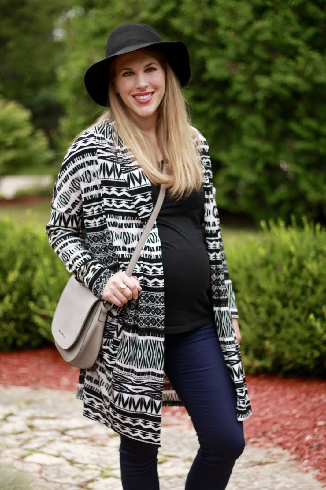 black tee, aztec cardigan, pinkblush maternity jeans, taupe booties, black wide brim hat, grey saddlebag, fall maternity outfit