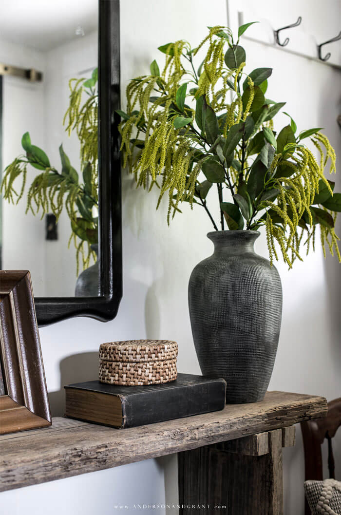 Vase and basket on entry table