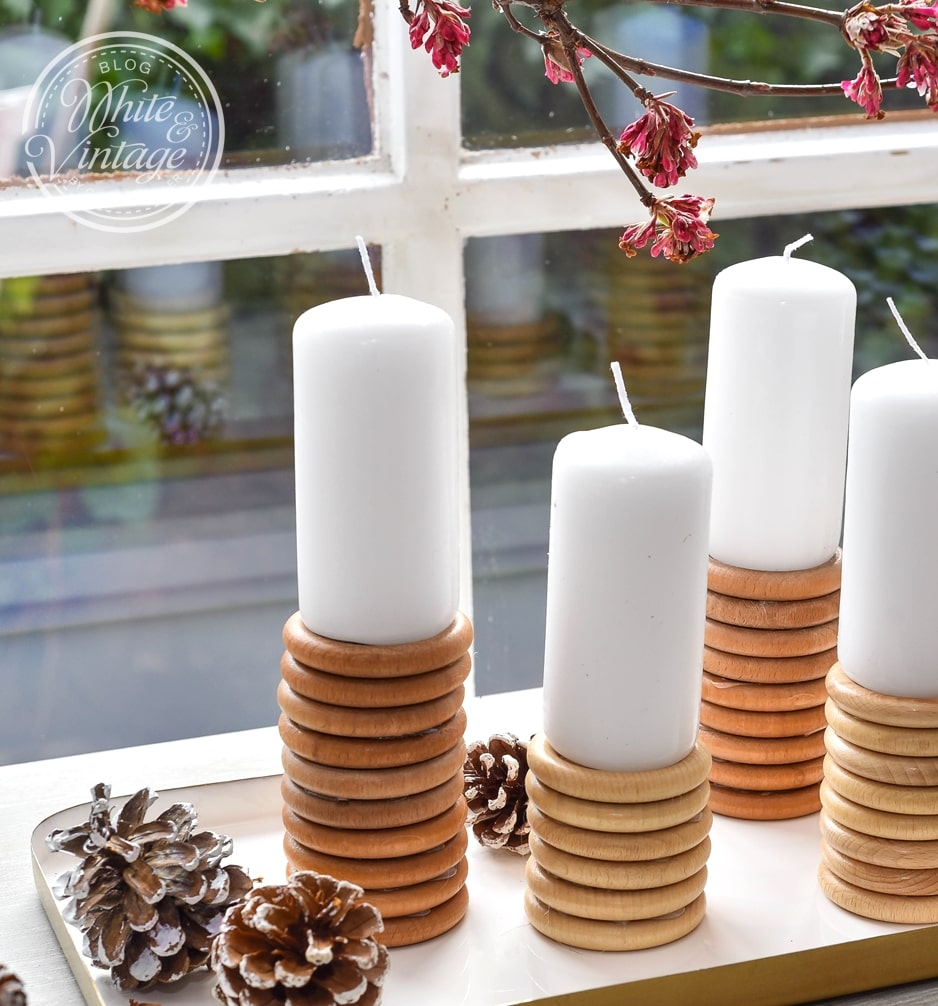 Aus Holzringen Kerzenständer selber machen.
