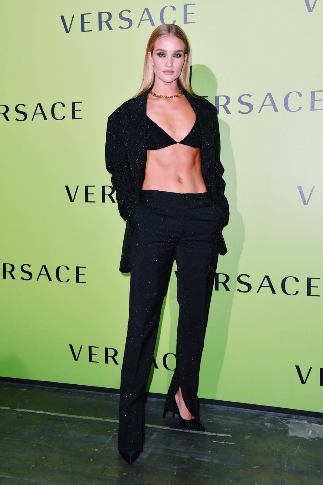 Rosie Huntington-Whiteley flaunts her washboard abs in a sparkly bra at Versace's Milan Fashion Week show