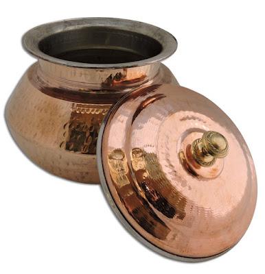 http://www.copperutensilonline.com/handmade-copper-biriyani-handi-with-lid.php