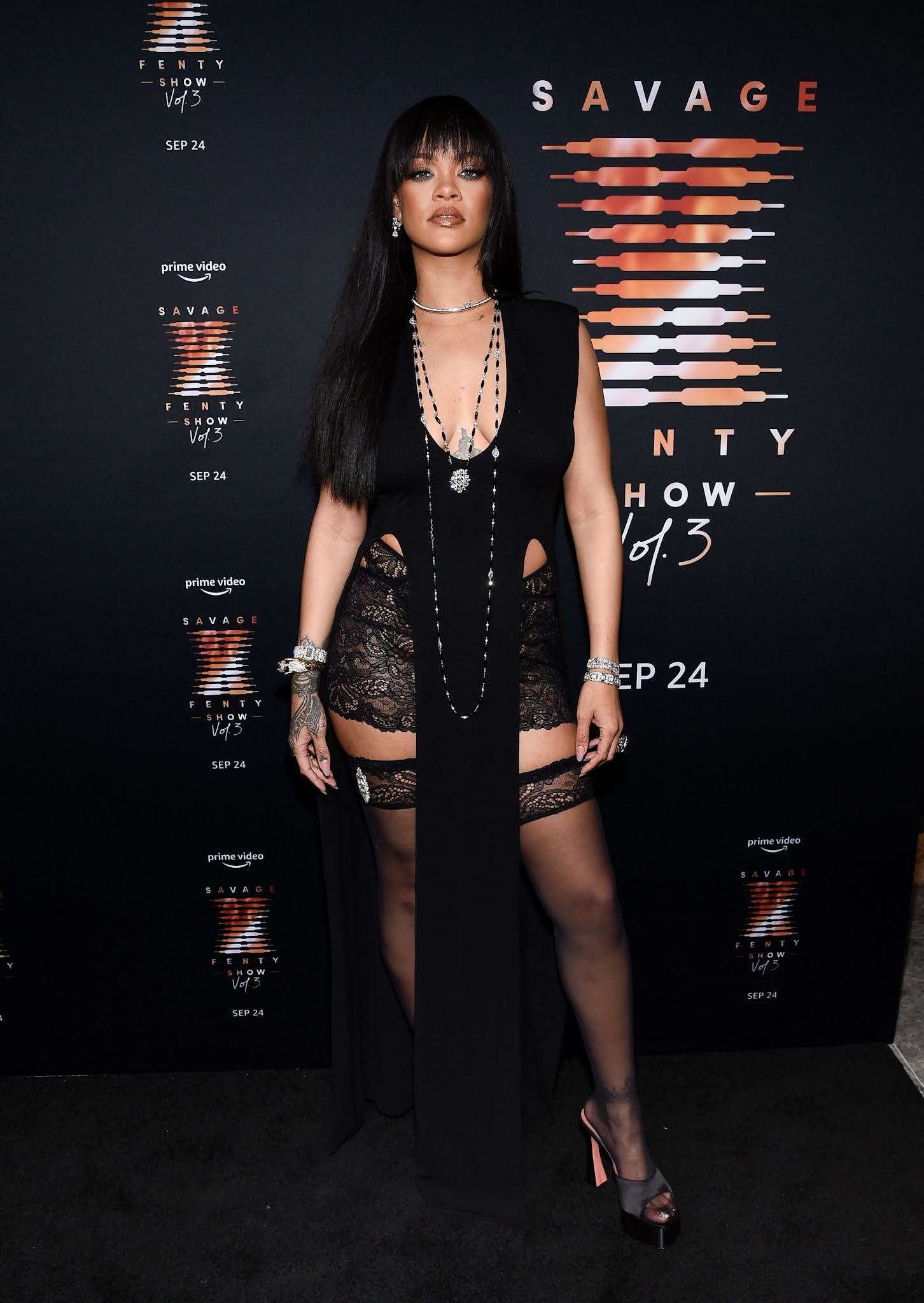 Rihanna in sheer lace shorts and stockings at Savage X Fenty show premiere in NYC