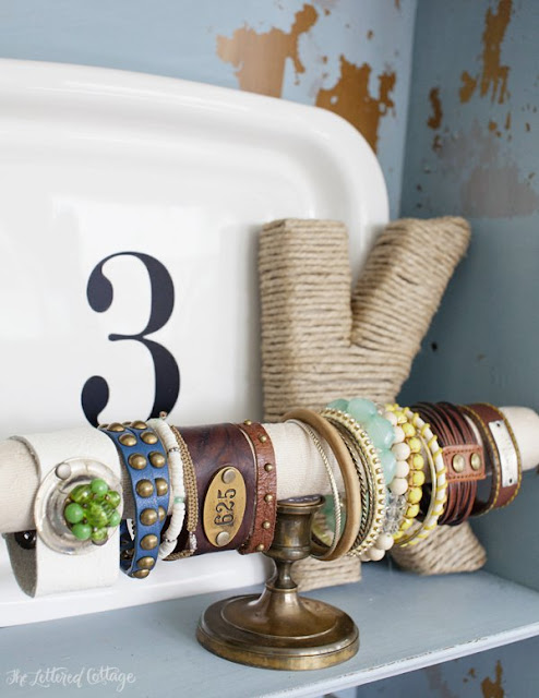 Various bracelets and anklets held in place by a bracelet display T-bar.