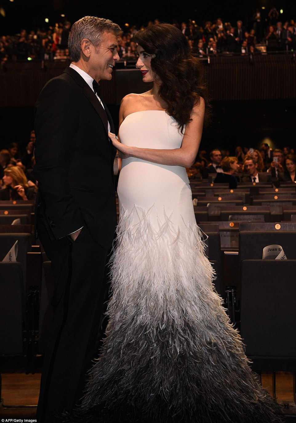Pregnant Amal Clooney Shows Off Baby Bump in Fitted Gown