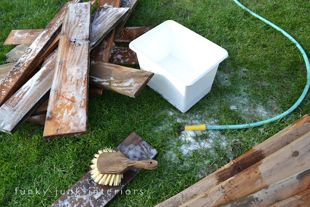 Learn how to clean reclaimed wood and stack it to dry so it doesn't warp.