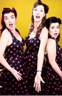 Vintage style photo of The Decibelles in polka dot dresses