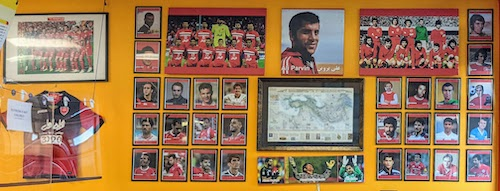 On one wall, a history in photos of Persepolis F.C.