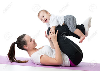 mother with baby doing gymnastics and health sports