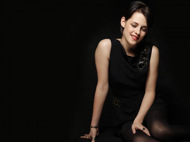 Kristen Stewart Smiling Dark Background Wallpaper