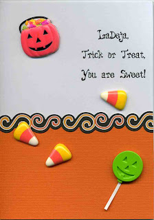 This sweet card is covered in candy embellishments. Personalized with a name