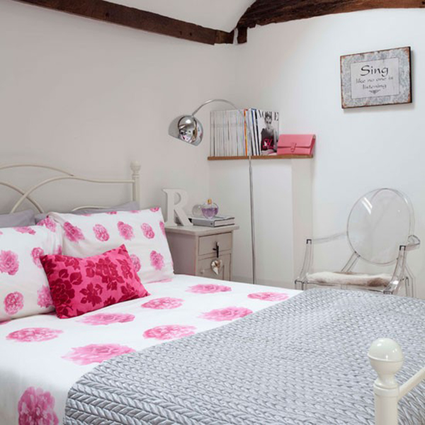 Rose and Floral Bedding Set on Cream Cast Iron bed in Country Bedroom