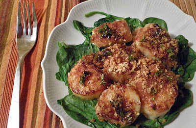 seared scallops au champagne gratin on bed of spinach