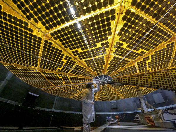 A technician inspects one of the twin solar panels for NASA's Lucy spacecraft at the Lockheed Martin facility in Denver, Colorado...in January of this year.