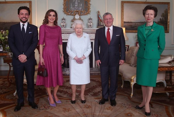Queen Elizabeth II, Princess Anne, Crown Prince Al Hussein. Queen Rania is wearing a pink Givenchy dress