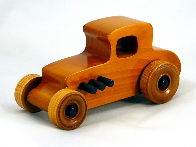 Left Front - Wooden Toy Car - Hot Rod Freaky Ford - 27 T Coupe - Pine - Amber Shellac - Black Hubs