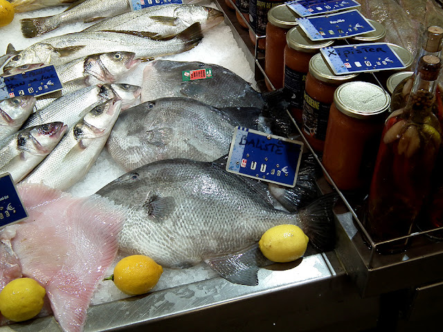 Sea bass (Fr. bar), trigger fish (Fr. baliste) and xipister sauce. Saint Jean de Luz fish market. Pyrenees-Atlantiques. France. Photographed by Susan Walter. Tour the Loire Valley with a classic car and a private guide.