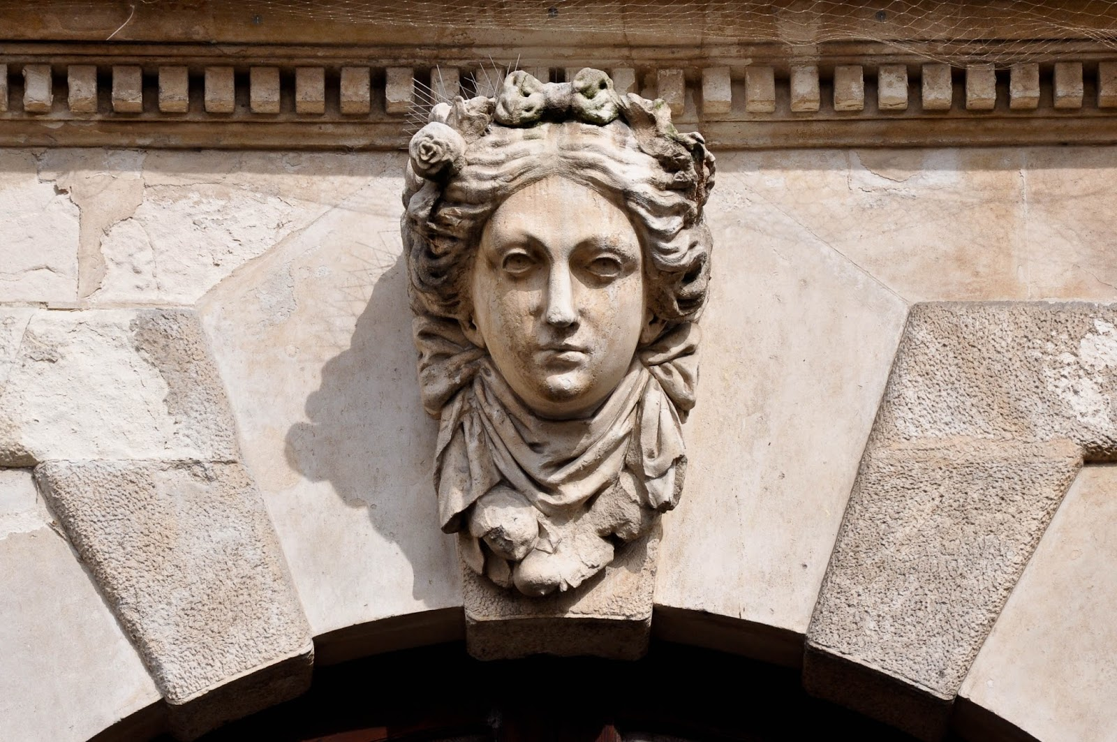 A female face on the facade of a building in Vicenza, Veneto, Italy