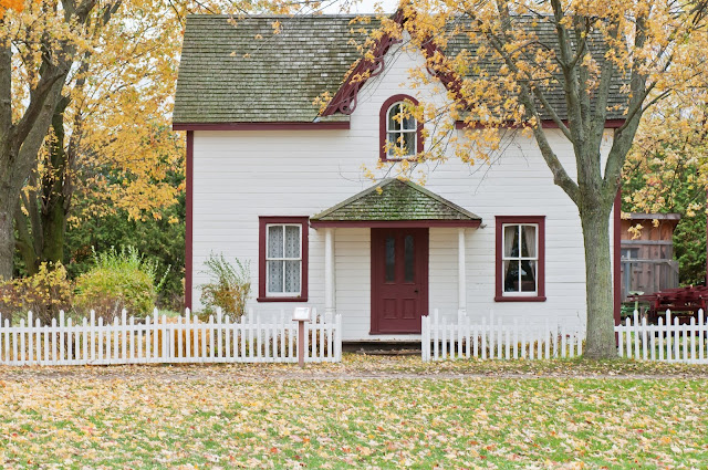 Pretty house behind a white picket fence