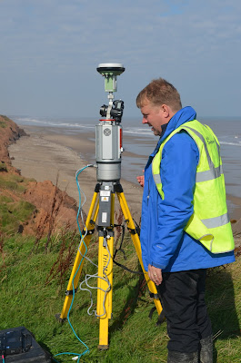 Matt Kirkham, Geotechnical Soils Lab Specialist,  carrying out Terrestrial LiDAR survey at the  Coastal Landslide Observatory,  Aldbrough, East Riding of Yorkshire