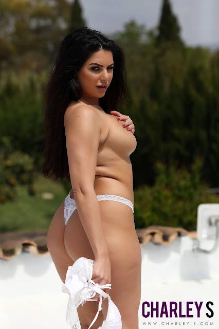 Charlotte Springer holding her white bra