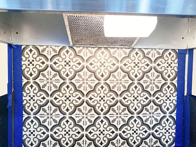 masking tape on both sides of the tiles for the caulk