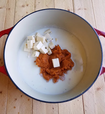 pumpkin, cheese and milk in large cast iron pot