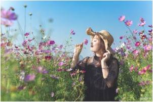 A woman in a field of purple flowers thinking about home renovation ideas for spring 2021