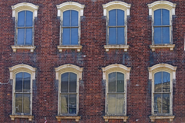 Period windows overlook Cobourg's old town...