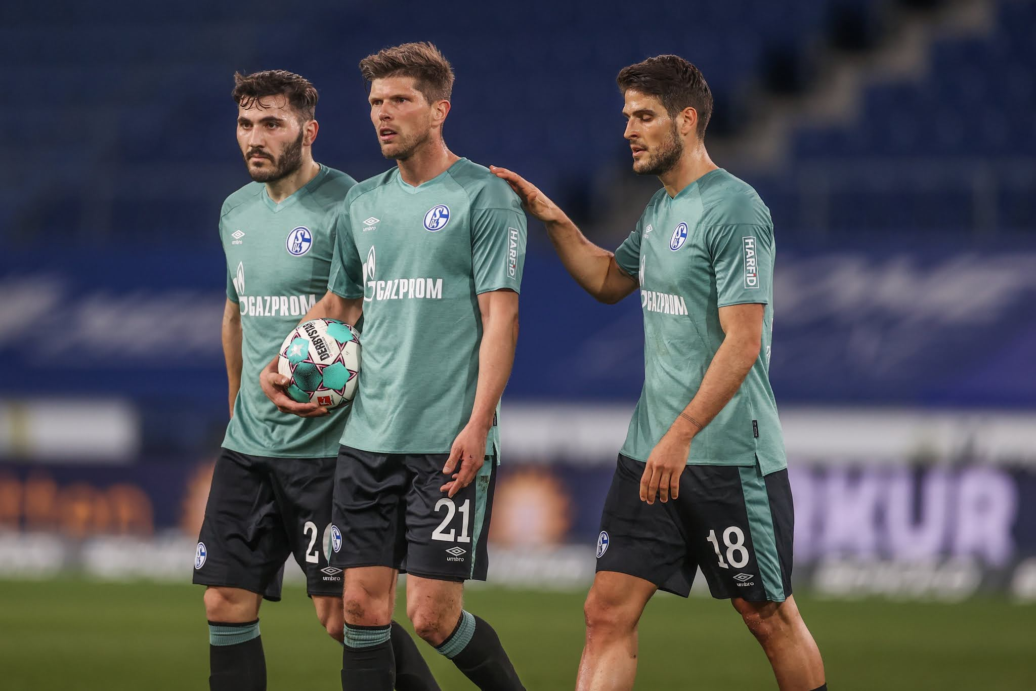 Schalke players react after losing to Arminia Bielefeld and being relegated from the Bundesliga