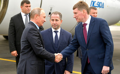 Vladimir Putin, Maxim Reshetnikov, Mikhail Babich