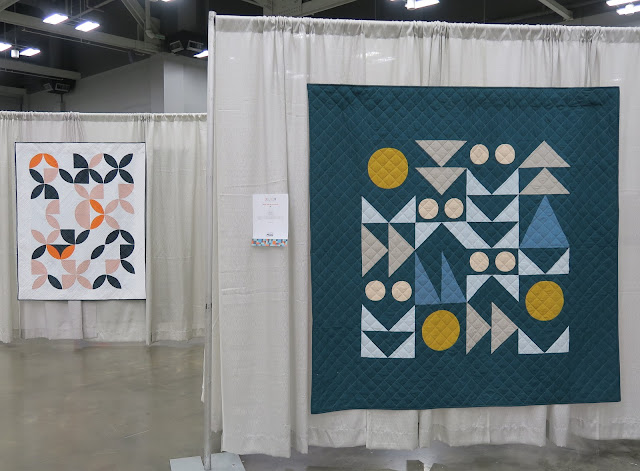Quiltcon 2020 - Disappearing Oranges by Cheryl Brickey and Folksy Quilt by Brigit Dermott