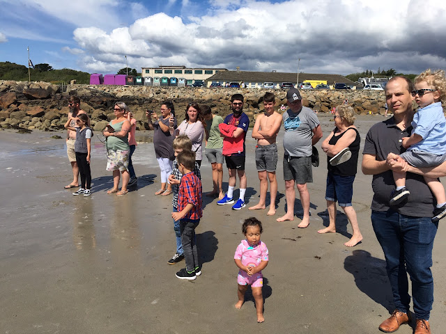 Most of her family who came down to the beach to watch.