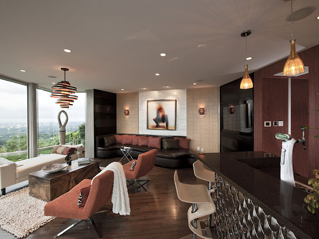 Picture of sofas and coffee tables by the bar in the entertainment room