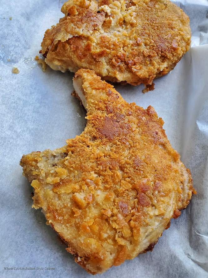 these are a cracker crumb coated pork chops there are two fried in the photo