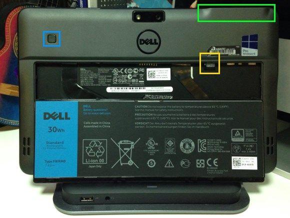 Visão traseira do Latitude 10, com a bateria removida. No destaque em amarelo está o slot para um SIM Card, em azul o leitor de impressões digitais, e em verde o slot para o leitor de Smart Cards