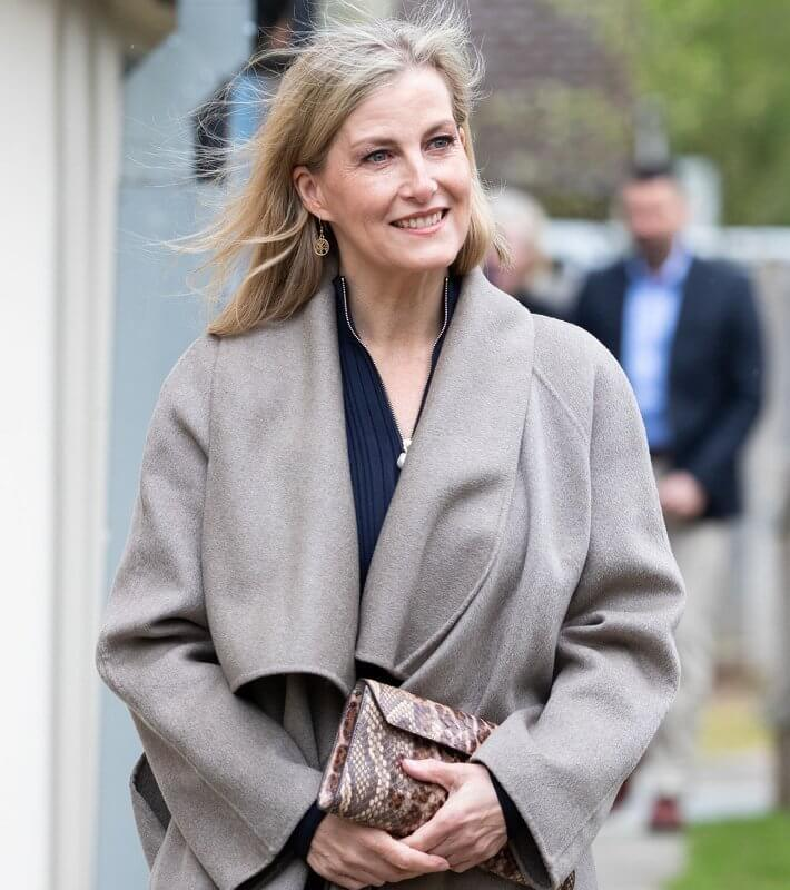 The Countess of Wessex wore a new pearl zip navy knitted pleat dress from ME+EM. Sophie Habsburg money penny clutch