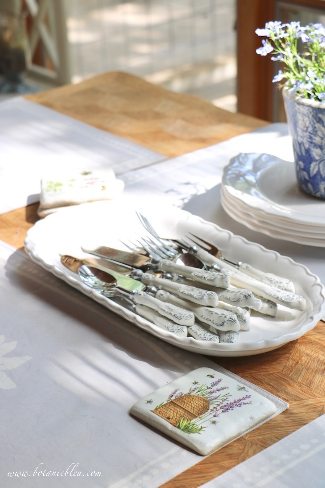 French Country Everyday Table Setting with lavender and bee coasters