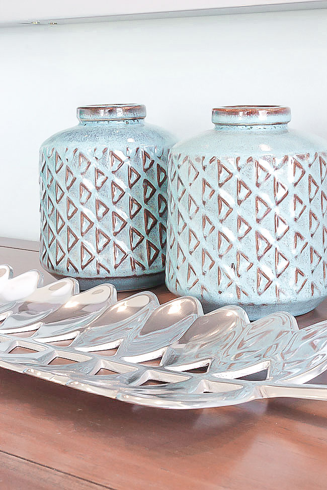 decor items can be placed all around your home - blue canisters and metallic leaf tray