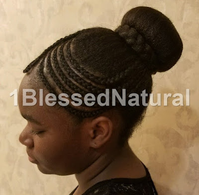 cornrows and bun with braid wrapped around