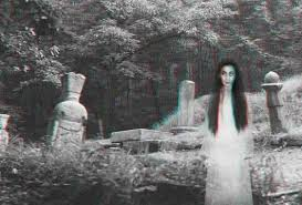 Ghost Kneeling in a Cemetery Caught on Video