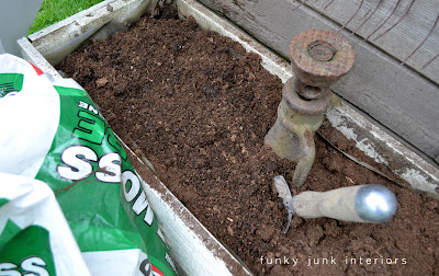 mixing peat moss with garden soil for a flowerbed