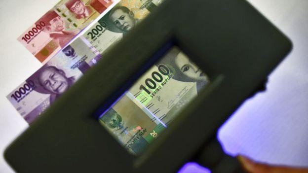 Ekonom Josua Pardede mengkhawatirkan adanya potensi krisis ekonomi jika ULN swasta meningkat - Foto: AFP / Tribun Medan