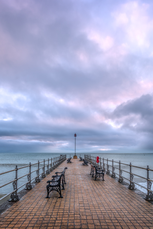 Swanage Banjo Pier at sunrise with colourful clouds in Dorset