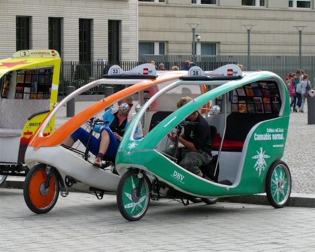 Bike taxi with an ad of the Deutscher Hanfverband, German Hemp Association, Platz des 18. März, Berlin
