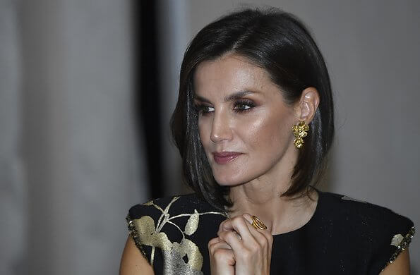 Queen Letizia wore a new embellished floral-jacquard midi dress by Dries Van Noten. gold earrings and pumps