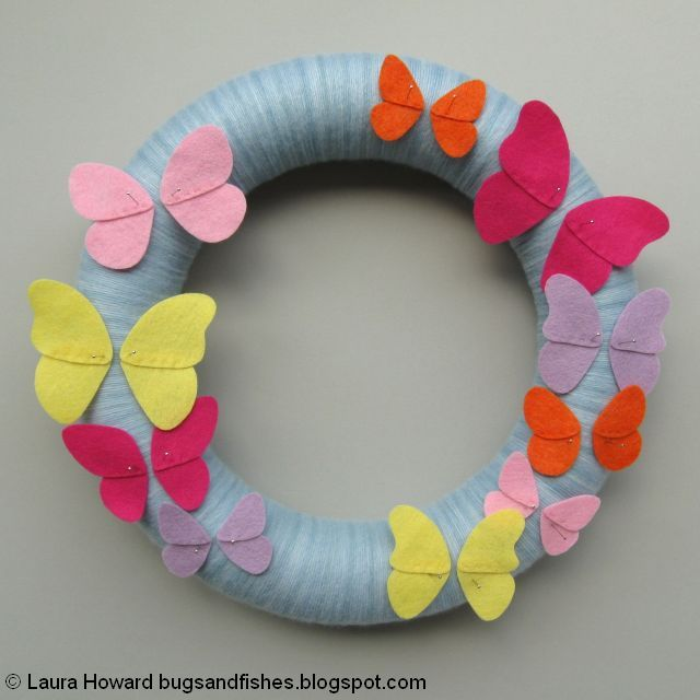 pinning the felt butterflies on the wreath