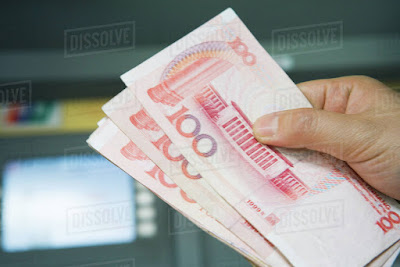 hand holding chinese yuan