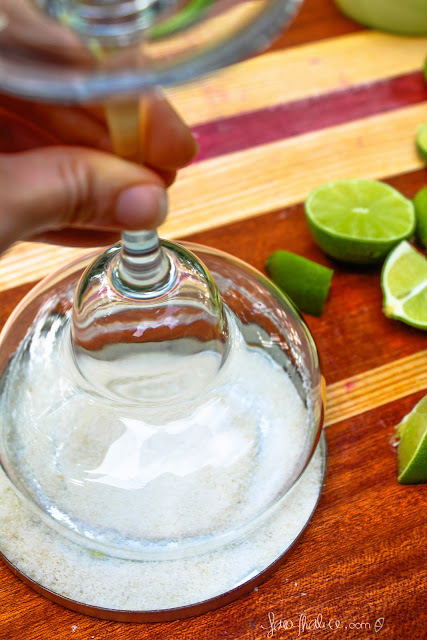 salting the rim of the margarita